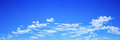 panorama of white clouds on blue sky for background and design Royalty Free Stock Photo