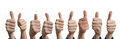 Panoramatic photo of many thumbs up. Isolated on white background