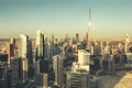 Panoramic cityscape of Dubai, UAE, with world tallest and futuristic skyscrapers at sunset Royalty Free Stock Photo