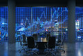 Panoramic conference room in modern office, cityscape of New York skyscrapers at night, Manhattan. Royalty Free Stock Photo