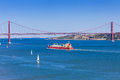 Panoramic of de abril bridge over tagus river in lisboa portugal Royalty Free Stock Image