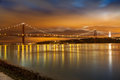 Panoramic of de abril bridge over tagus river in lisbon at night portugal Royalty Free Stock Photos