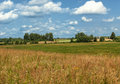 Panoramic farm wild landscape a few wooden houses away Stock Images