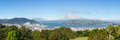 Panoramic landscape otago bay dunedin broad of the peninsula and with the city of in the foreground and clouds hanging over the Royalty Free Stock Image