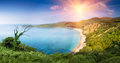 Panoramic landscape of the rocky coastline sea and Jaz Beach at sunshine. Budva, Montenegro. Royalty Free Stock Photo
