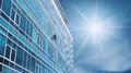 Panoramic Modern Building Facade with one opened Window, on blue sky with bright sunshine Royalty Free Stock Photo