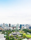Panoramic modern city skyline bird eye aerial view with zojo-ji temple shrine from tokyo tower under dramatic sunrise and morning Royalty Free Stock Photo