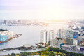 Panoramic modern cityscape building bird eye aerial view of Odaiba bay and rainbow bridge under sunrise and morning blue bright sk Royalty Free Stock Photo