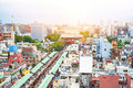 Panoramic modern cityscape building bird eye aerial view of Sensoji shrine under sunrise and morning blue bright sky in Tokyo, Jap Royalty Free Stock Photo
