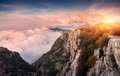Panoramic mountain landscape at sunset. Amazing view from mountain peak Royalty Free Stock Photo