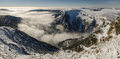 Panoramic picture of obri dul valley giant mountains czech republic winter inversion weather in in Stock Photos
