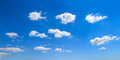 Panoramic sky view of blue bright cloudy day Royalty Free Stock Image