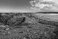 Panoramic view on atlantic coastline with broken wooden bridge after collision