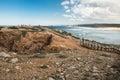Panoramic view on atlantic coastline with broken wooden bridge