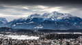 Panoramic view on Austrian Alps covered by snow at cloudy day Royalty Free Stock Photo