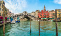 Panoramic view of famous Canal Grande with famous Rialto Bridge in Venice, Italy Royalty Free Stock Photo