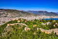 Panoramic view on castle walls, lower castle and city from the upper castle in Alanya Royalty Free Stock Photo