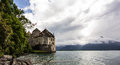 Panoramic view of Chateau de Chillon at Lake Geneva, one of Switzerland`s most visited castles in Europe, with sky full of cloud
