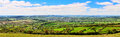Panoramic view of dartmoor and tavistock on with patchwork fields in the foreground Royalty Free Stock Images