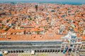 A view of the red tiled roofs of the houses and the Dodge Palace at the half of San Marco in Venice, Italy