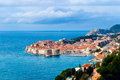 Panoramic view of dubrovnik old town sunny day and spring clouds over the beautuful Royalty Free Stock Photos