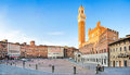Panoramic view of famous piazza del campo in siena at sunset tuscany italy Stock Photos