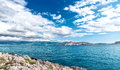 Panoramic view of island coastline landscape, calm water, clear sky on a sunny vacation day. Seaside resort as destination Royalty Free Stock Photo