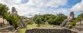 Panoramic view of Mayan Temples of Gran Plaza or Plaza Mayor at Tikal National Park - Guatemala Royalty Free Stock Photo