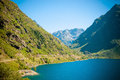Panoramic view of mountains and lake in pyrenees lanscape Stock Photo