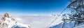 Panoramic view of mountains peaks in french alps covered with clouds at meribel skiing resort Stock Image