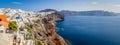 Panoramic view of Oia town, rocks and sea, Santorini island, Greece Royalty Free Stock Photo
