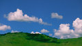 Panoramic view over the green valley with blue sky and white clo Royalty Free Stock Photo