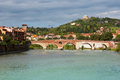 Panoramic view of ponte pietra in verona italy in a bright sunny day with dramatic clouds at the background Stock Photos