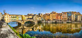 Panoramic view of Ponte Vecchio with river Arno at sunset, Florence, Italy Royalty Free Stock Photo