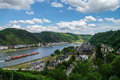 Panoramic view of sank goar and snak goarshausen medival village rhine vineyards on slope the hills in germany cargo ship Royalty Free Stock Images