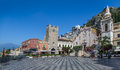 Panoramic view of Taormina main square with Mount Etna Volcano on background - Taormina, Sicily, Italy Royalty Free Stock Photo