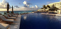 Panoramic view to the swimming pool in the resort at sunrise tim time cancun mexico Royalty Free Stock Images