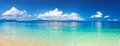 Panoramic view of tropical beach. Royalty Free Stock Photo