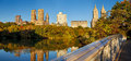 Panoramic view of upper west side from the bow bridge horizontal central park in fall over lake central park trees and Stock Images