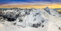 Panoramic view of winter mountains at colorful sunset