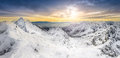 Panoramic view of winter mountains at sunset