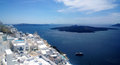 Panoramic views of the coast of Fira in Santorini island on a hot summer day Royalty Free Stock Photo