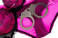 Panties bra handcuffs isolated white background Stock Photography