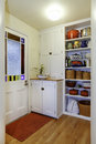 Pantry view with storage shelves in Small hallway. Royalty Free Stock Photo