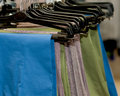 Pants on hangers group of colored in the store Royalty Free Stock Image
