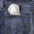 Pantyliner and jeans Royalty Free Stock Photo