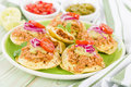 Panuchos mexican corn tortillas filled with refried beans and topped with shredded chicken guacamole pickled red onions and tomato Stock Photography
