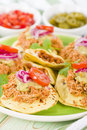 Panuchos mexican corn tortillas filled with refried beans and topped with shredded chicken guacamole pickled red onions and tomato Royalty Free Stock Image