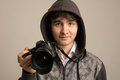 Paparazzi man taking picture with photo  DSLR digital camera Royalty Free Stock Photo