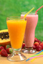 Papaya juice and strawberry milkshake with straws selective focus focus on the straw in the Royalty Free Stock Image